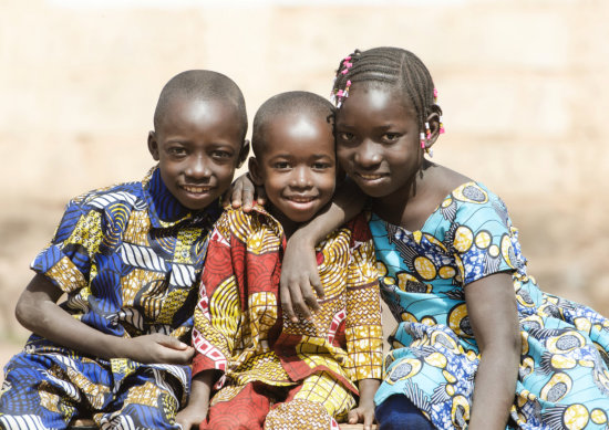 three little kids smiling
