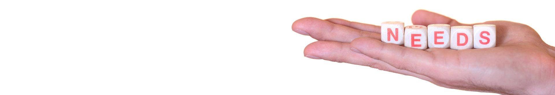 hand holding text blocks